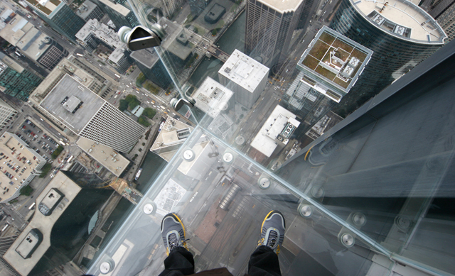 The glass walls and floor of the Willis Tower Skydeck in Chicago behave like a solid but look more like a liquid at the atomic level. (Photo: Olga Bandelowa)