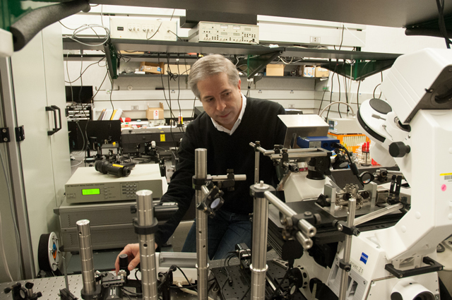Henri Lezec, a scientist at the National Institute of Standards and Technology in Gaithersburg, Md., aligning the optical system with which he and his colleagues demonstrated 3-D negative refraction of ultraviolet light for the first time.