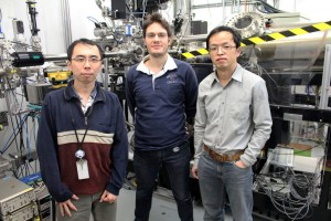 Ronny Sutarto, left, Riccardo Comin and Feizhou He with the X-ray diffractometer at the Canadian Light Source that they used in their recent study.