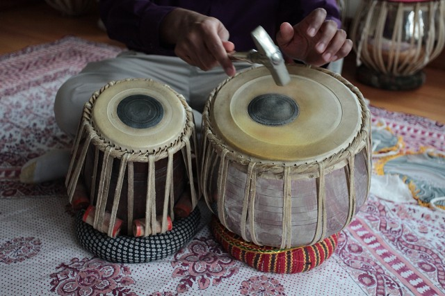 Playing the tabla.