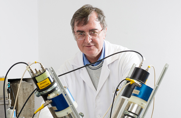 Attila Krasznahorkay of the Atomki research group in Debrecen, Hungary, with the spectrometer used to detect possible evidence of a new particle.