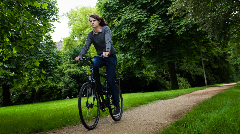 Photo of Dr. Peter Scholze riding a bicycle