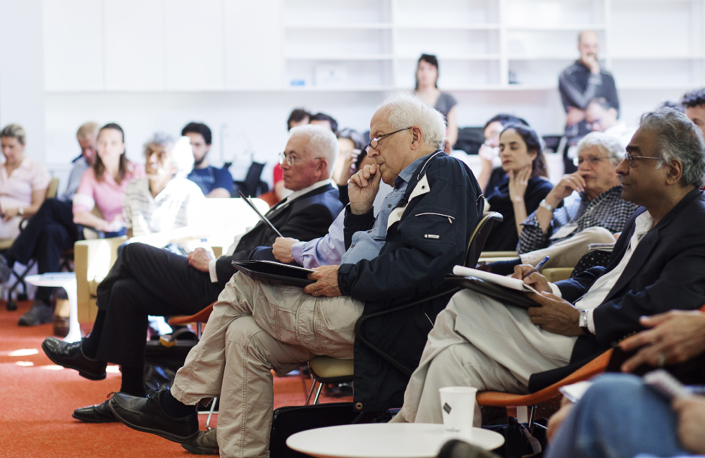 George Ellis, a cosmologist at the University of Cape Town, listens to a presentation.