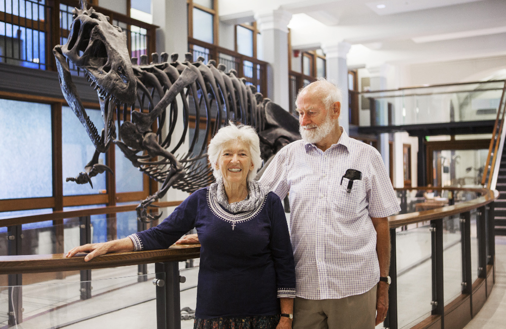 Peter and Rosemary Grant in front of an Allosaurus in Princeton University's Guyot Hall.