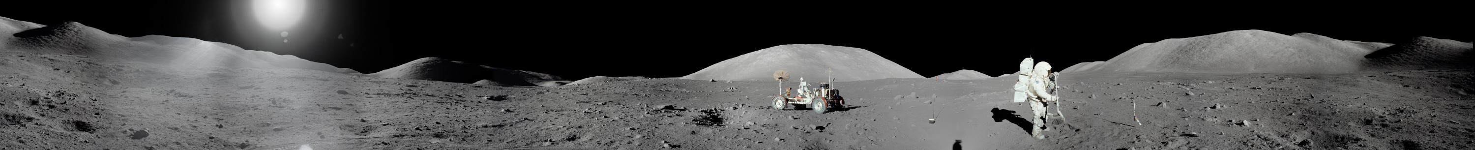 Panorama of the Taurus-Littrow valley created from photographs by Apollo 17 astronaut Eugene Cernan. Fellow astronaut Harrison Schmitt is shown using a rake to collect samples.