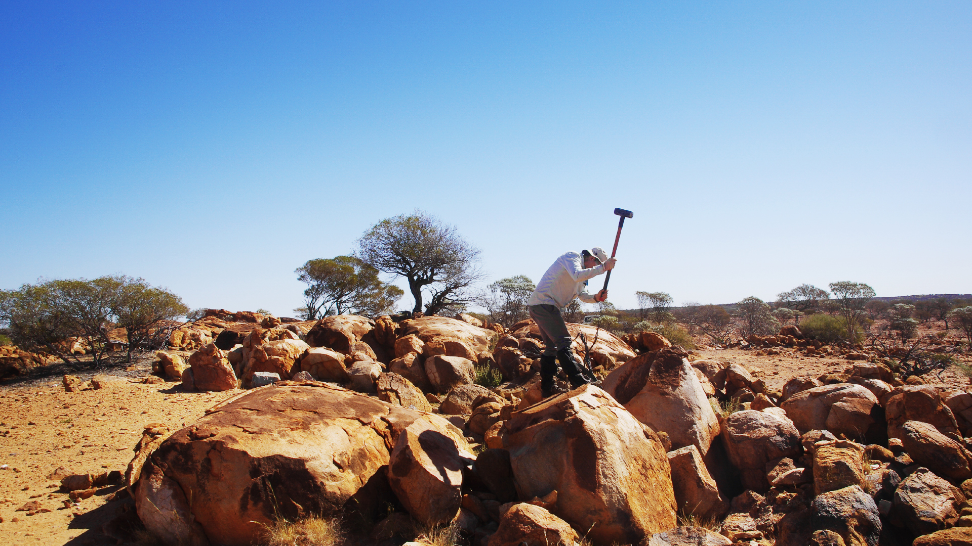 <p>Tim Elliott collecting samples of ancient crust rock in Yilgarn Craton in Western Australia.</p>