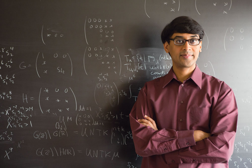 Photo of Manjul Bhargava at his blackboard