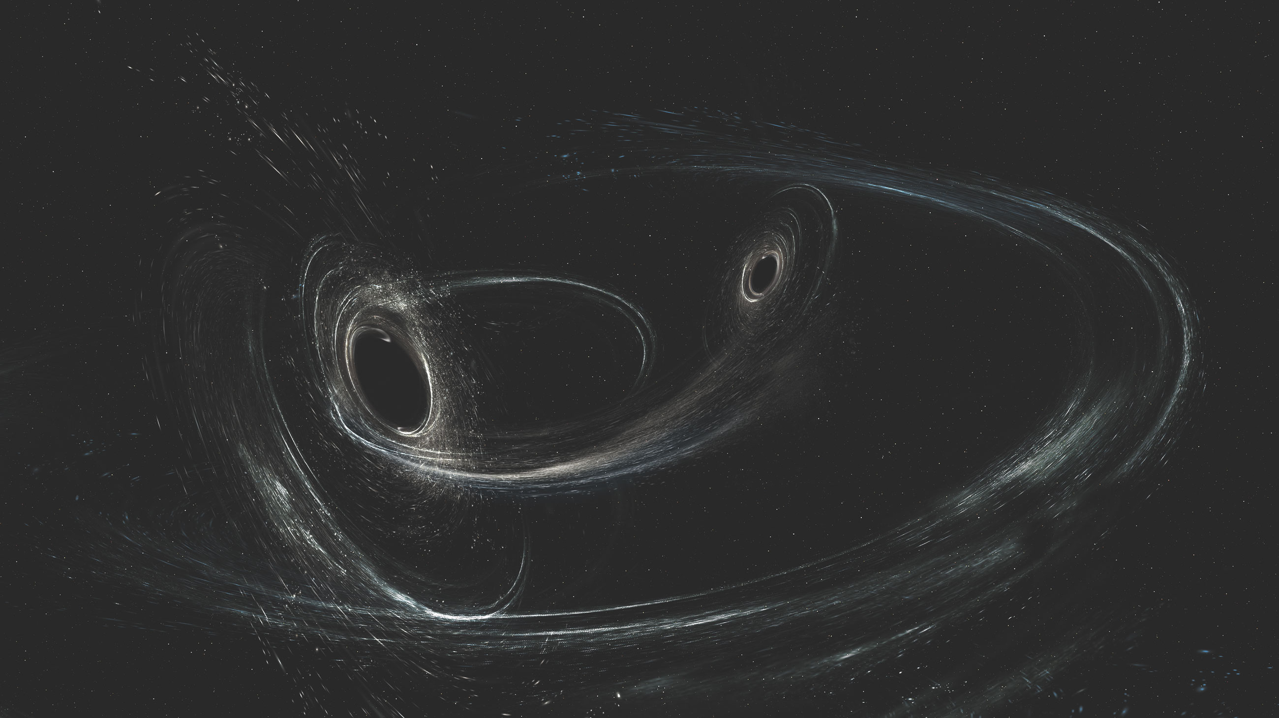An illustration of a newly detected black-hole merger, whose gravitational-wave signal suggests that at least one of the black holes was misaligned with its orbital motion before merging with its partner.
