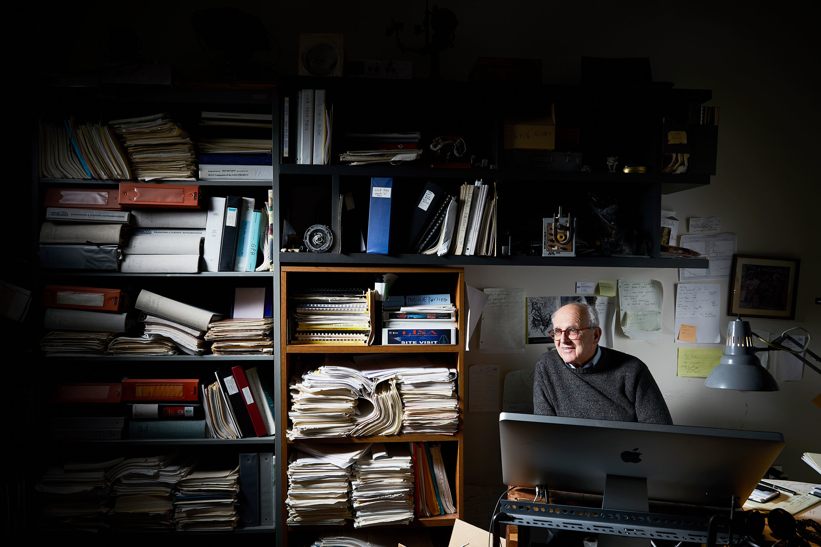 "Weiss in his office at MIT, where he doesn't like to work. ""Nobody thinks at their goddamn desk,"" he told the photographer. ""They only answer annoying emails and phone calls. I do my thinking while I'm working with my hands in my electronics lab or on a lathe in the machine shop."" (Editor's note: The phone numbers in this photograph were blurred to protect privacy.)"