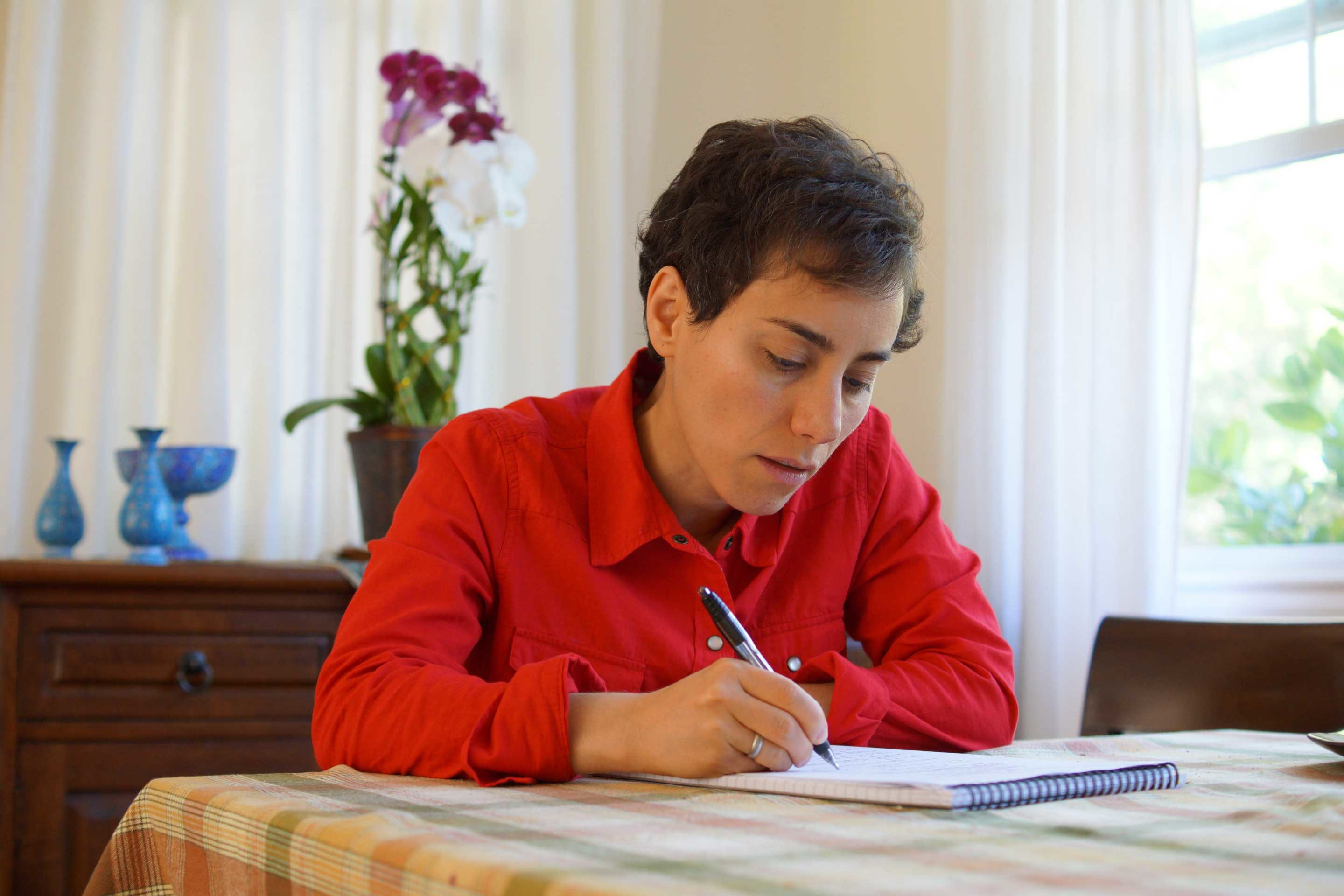 Maryam Mirzakhani writing