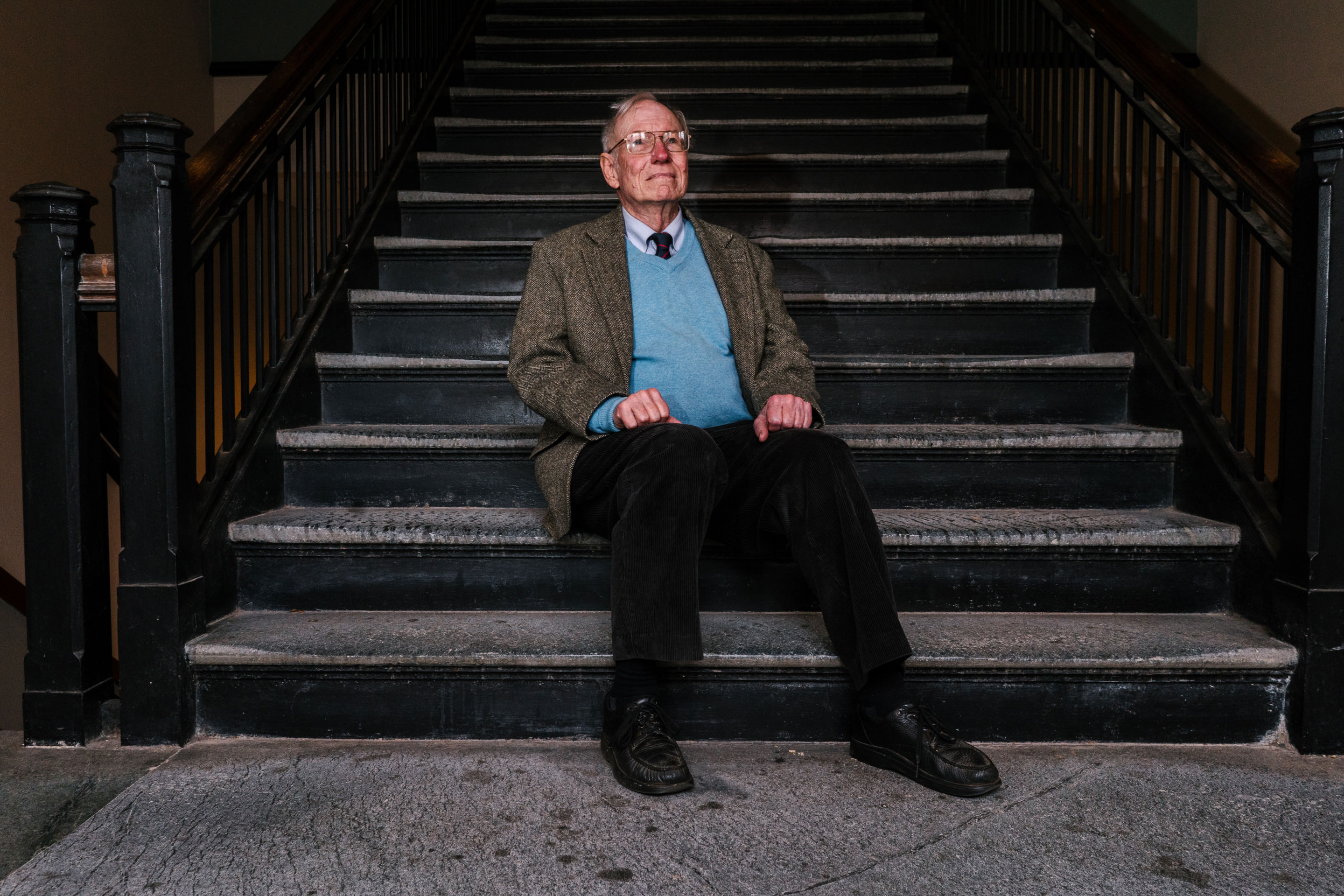 Dr. Jason Morgan, a geophysicist, poses for a portrait in Guyot Hall, home of the geosciences department at Princeton University. He has since retired and moved to Boston, where he is a visiting scholar at Harvard. The steps in the stairwell are made of Serpentine rock, which is formed in the Earth's mantle.