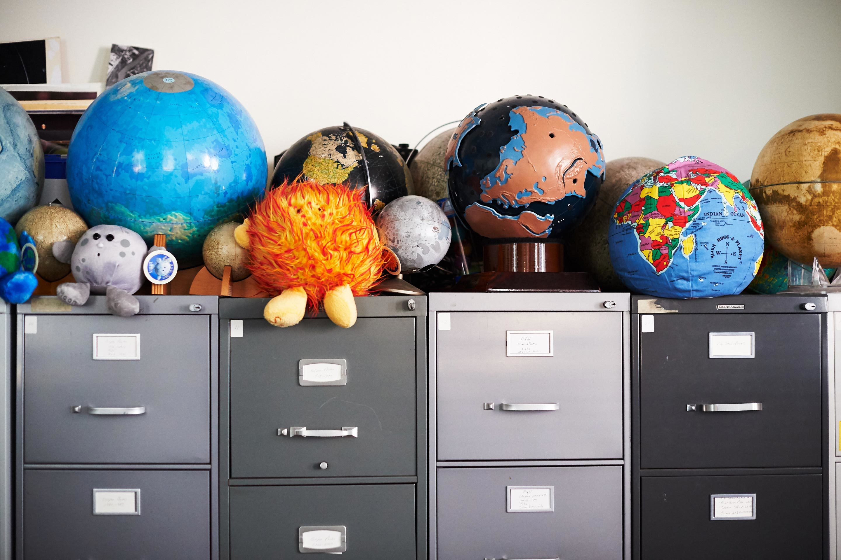 Globes — including stuffed versions of the sun, Earth and moon — line Pasachoff's office.