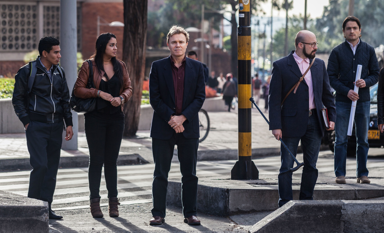Neil Johnson (center) in Bogota, Colombia, in July.