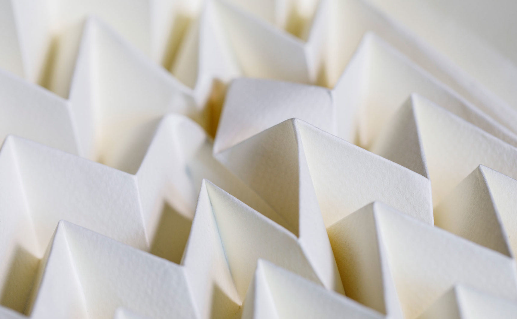 A defect in a beige sheet of Miura-ori