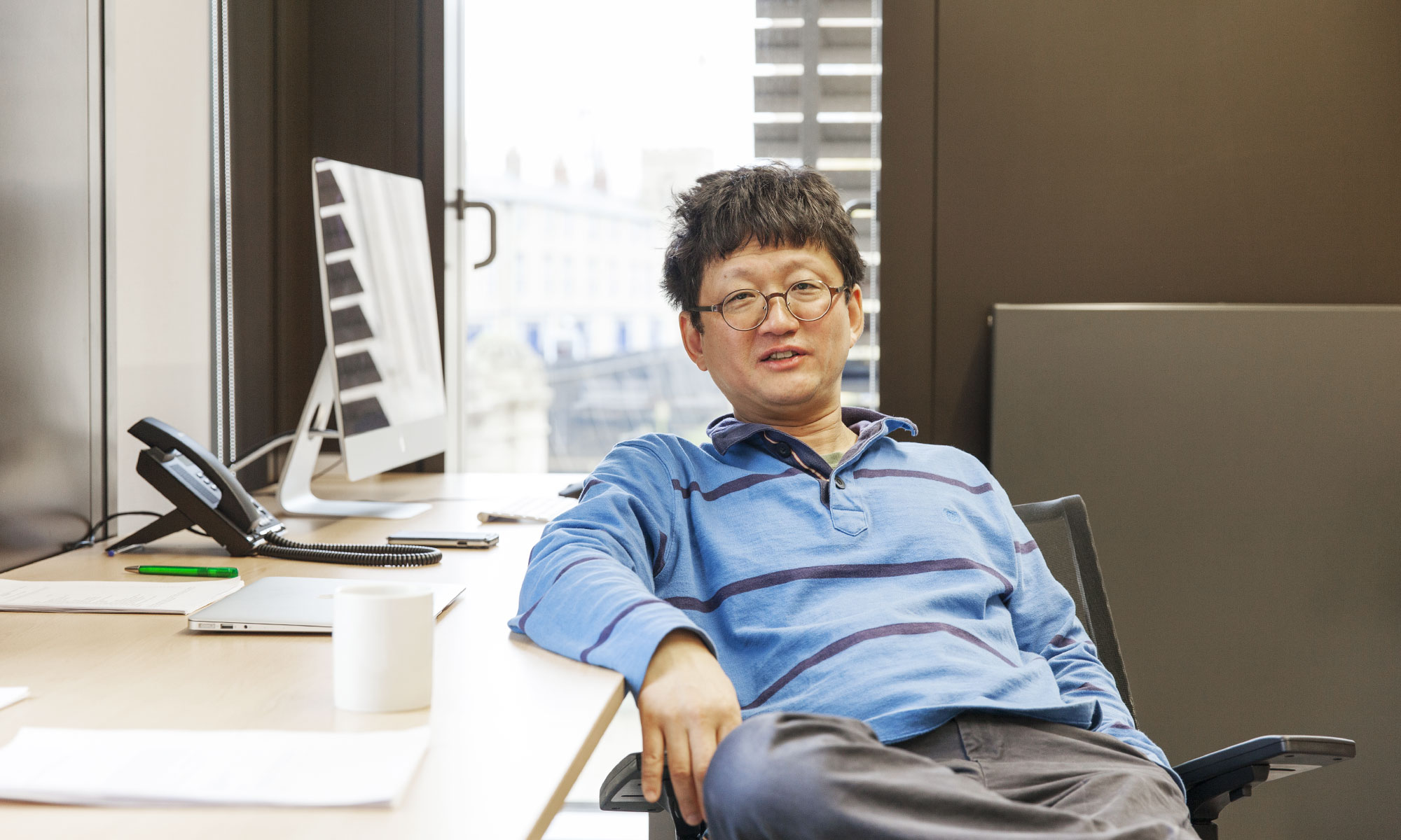 Minhyong Kim in his office