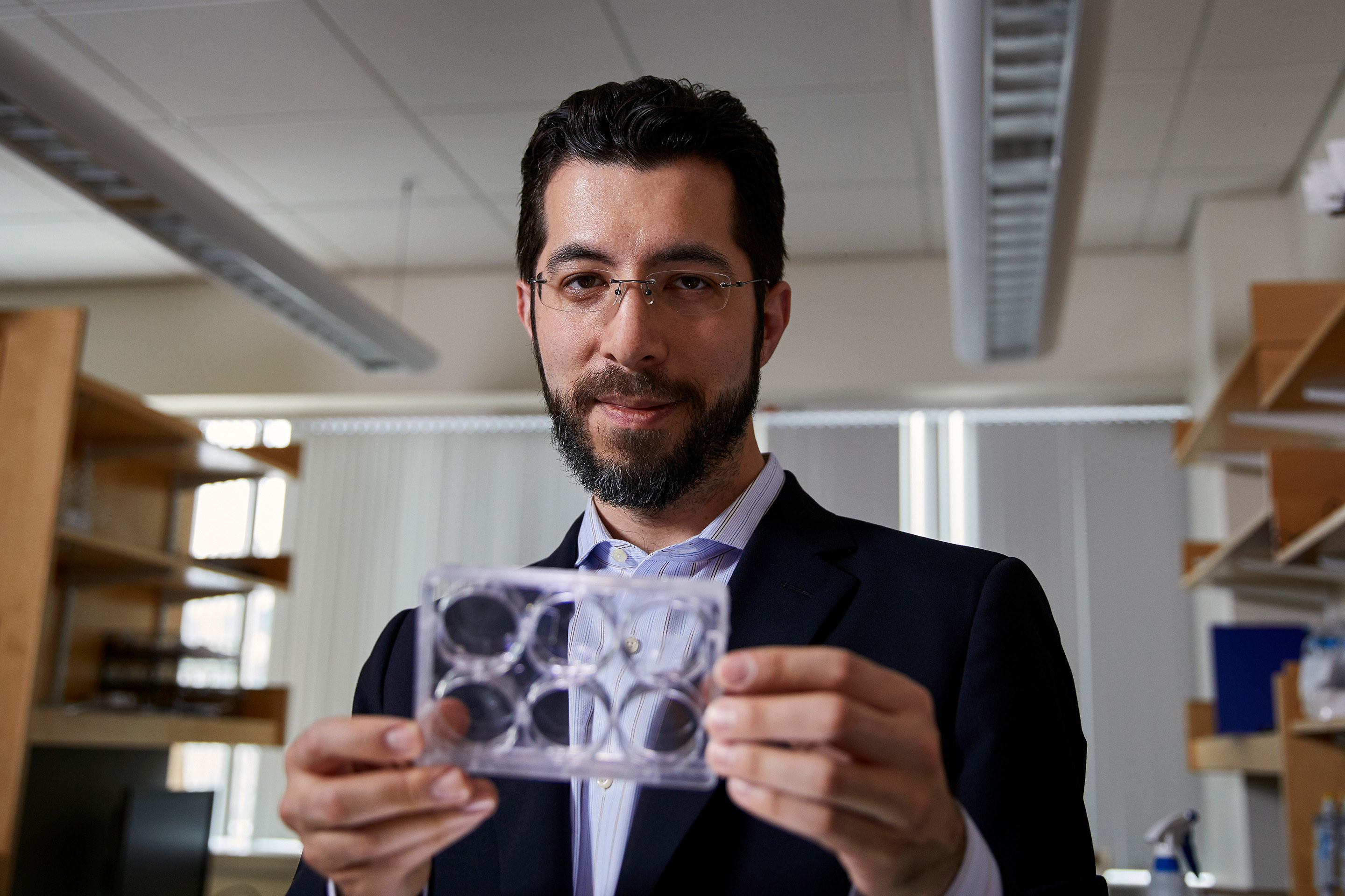 Lede photo of Ed boyden holding samples
