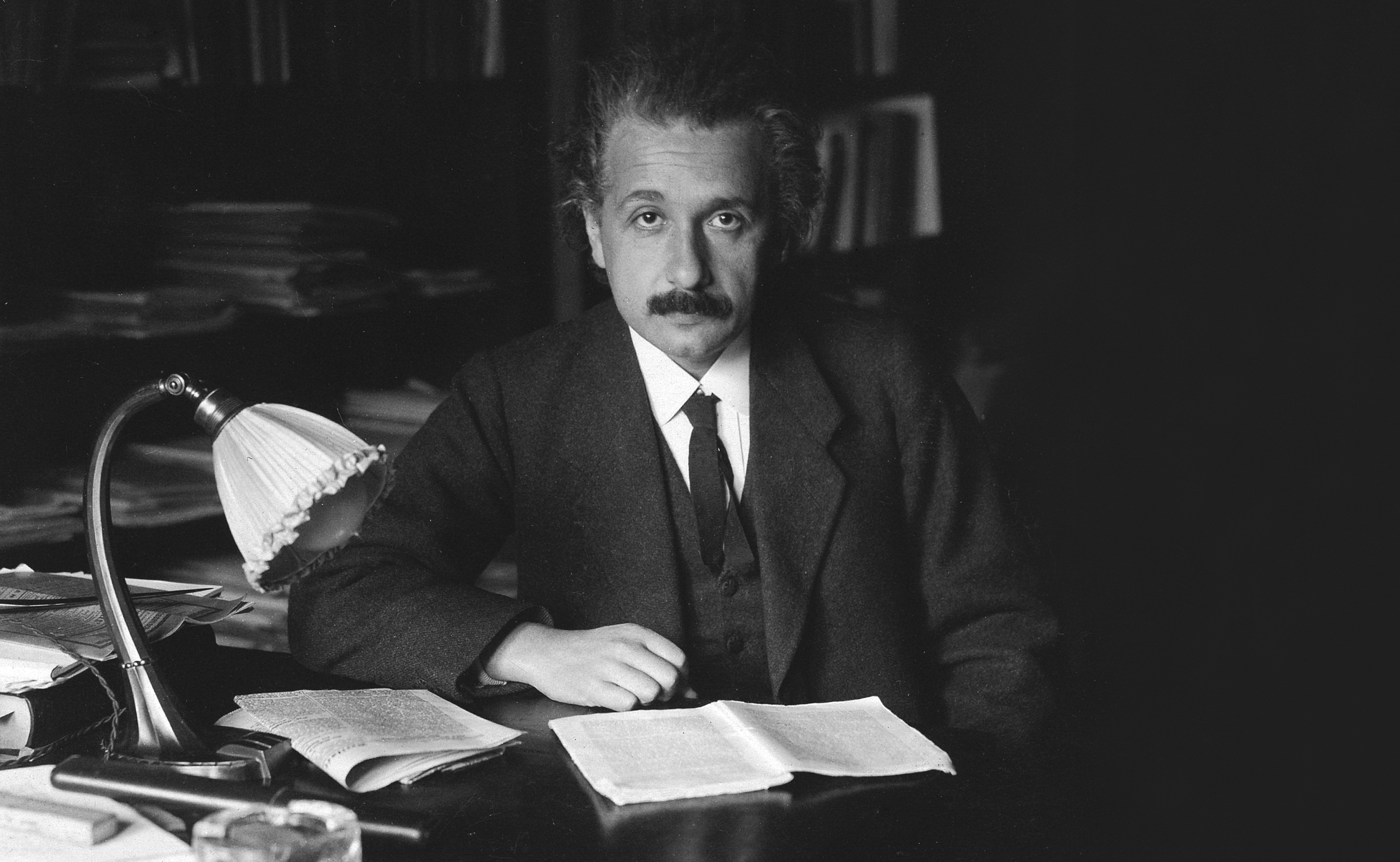 Photograph of Albert Einstein in his office at the University of Berlin, published in the USA in 1920.