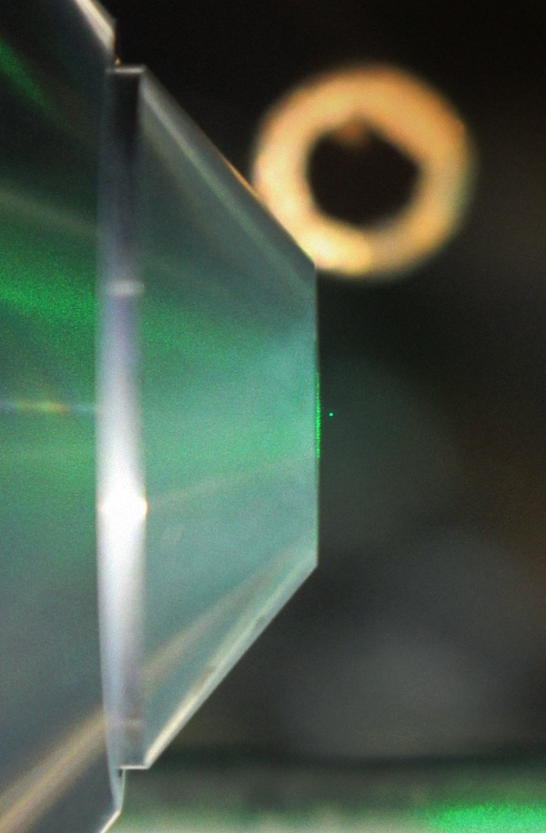 levitating nanodiamond (green dot)