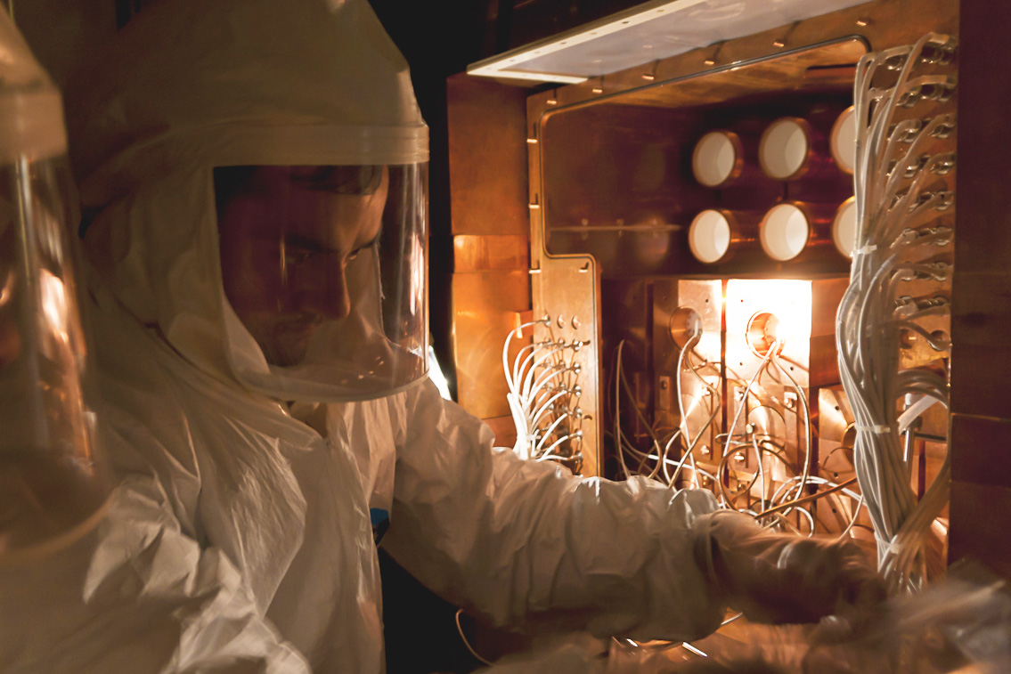 Photo of a technician working on detectors for the DAMA/LIBRA project.