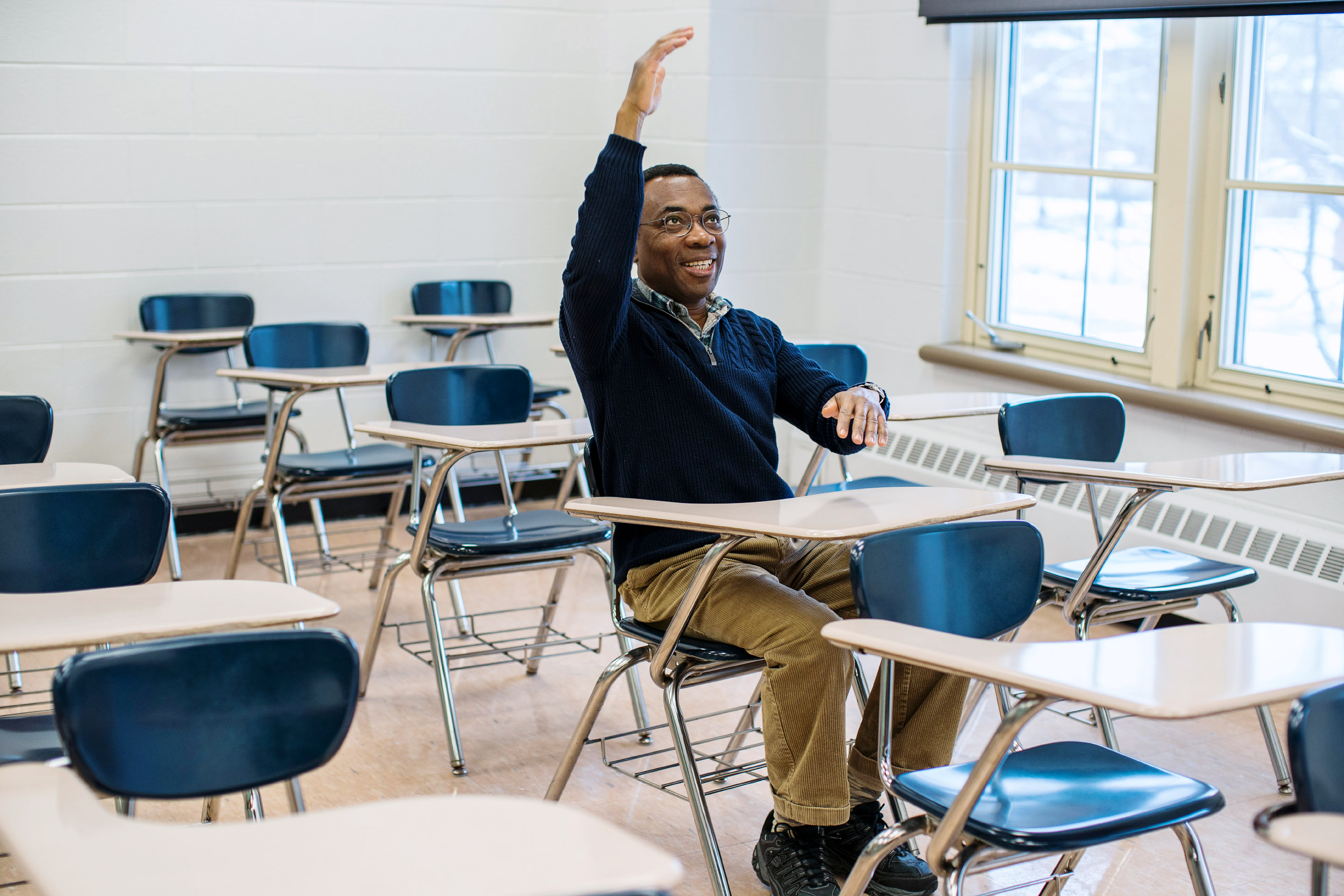 Photo of mathematician Donald Richards sitting in a Pennsylvania State University classroom.
