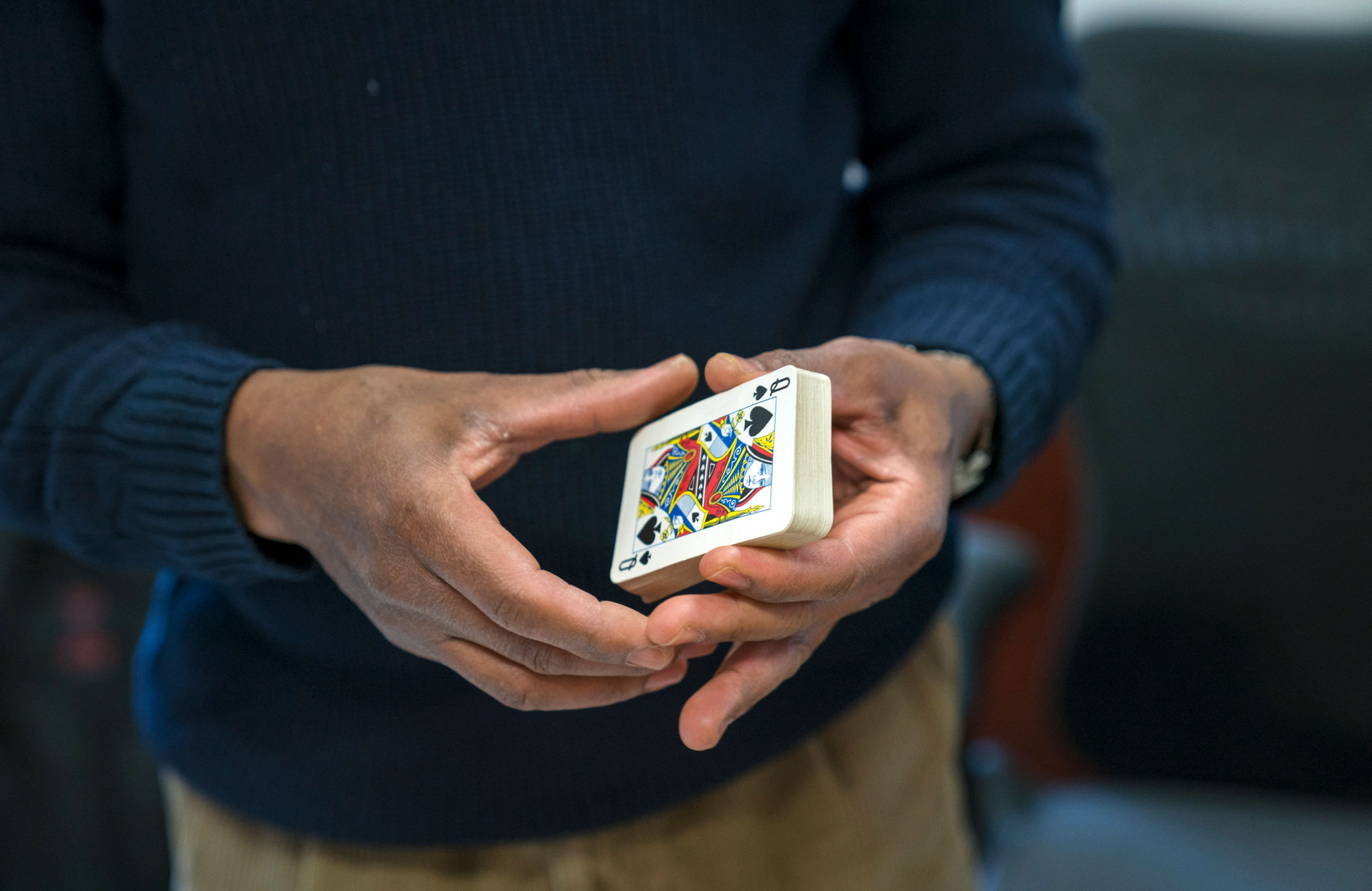 Photo of mathematician Donald Richards holding a deck of cards.