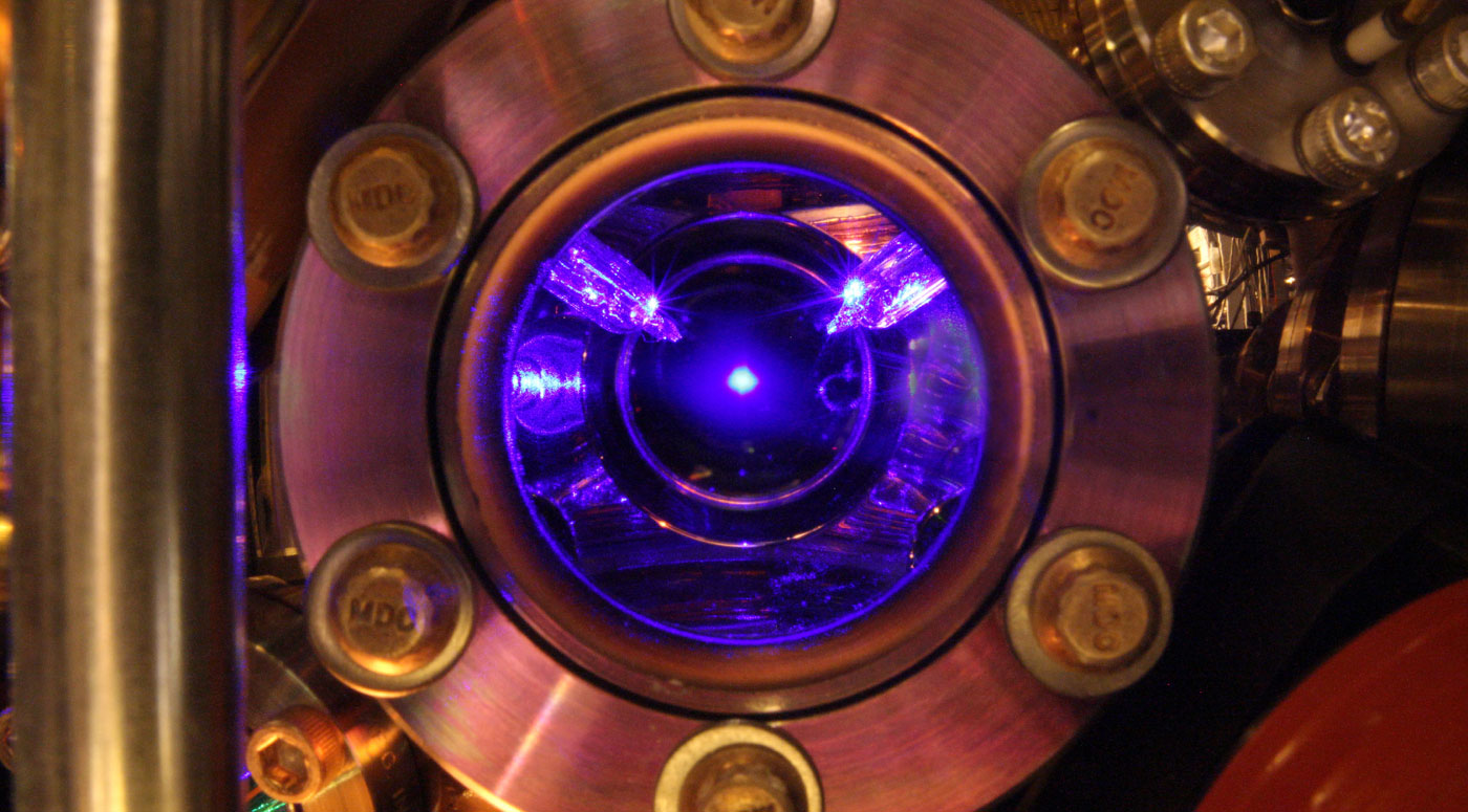 Photo looking into the vacuum chamber from one of the viewports, the collection of cold Sr atoms is visible in the center, and the calibrated thermal sensors can also be seen.