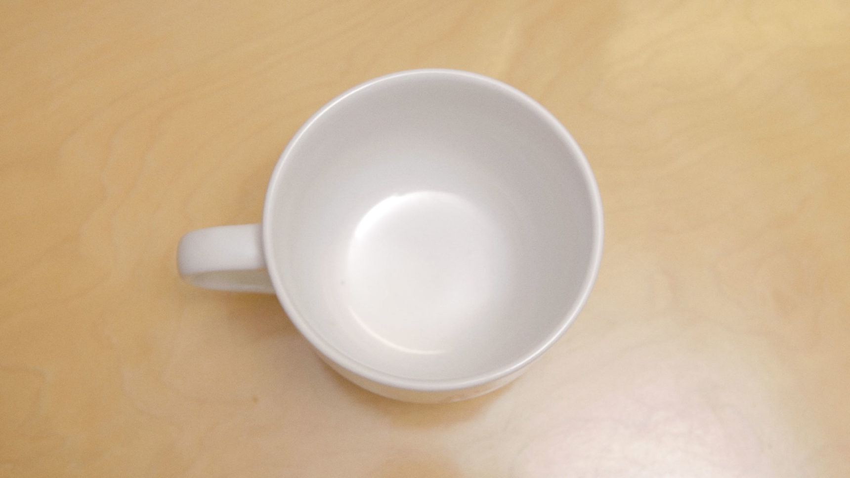 "The Stanford mathematician Tadashi Tokieda demonstrates one of his physics ""toys"": the curious higher and lower notes you hear when tapping a coffee mug with a spoon."