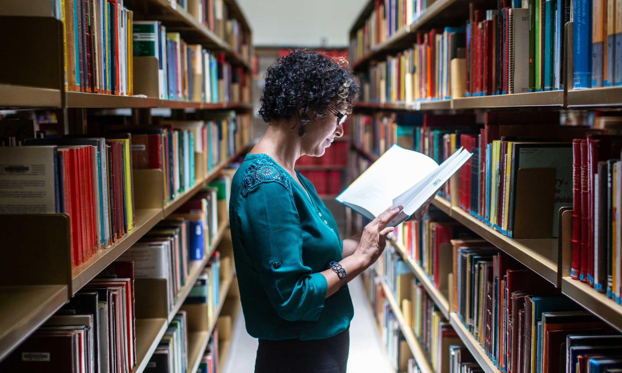 Carolina Araujo in the library at IMPA