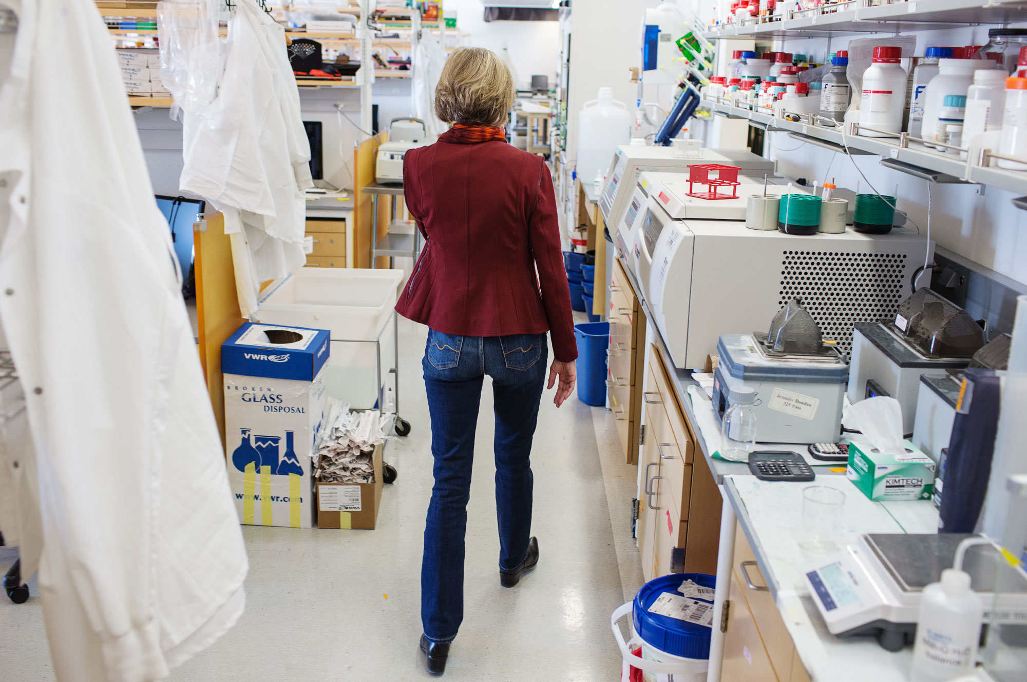PHOTO: Doudna walks in her lab
