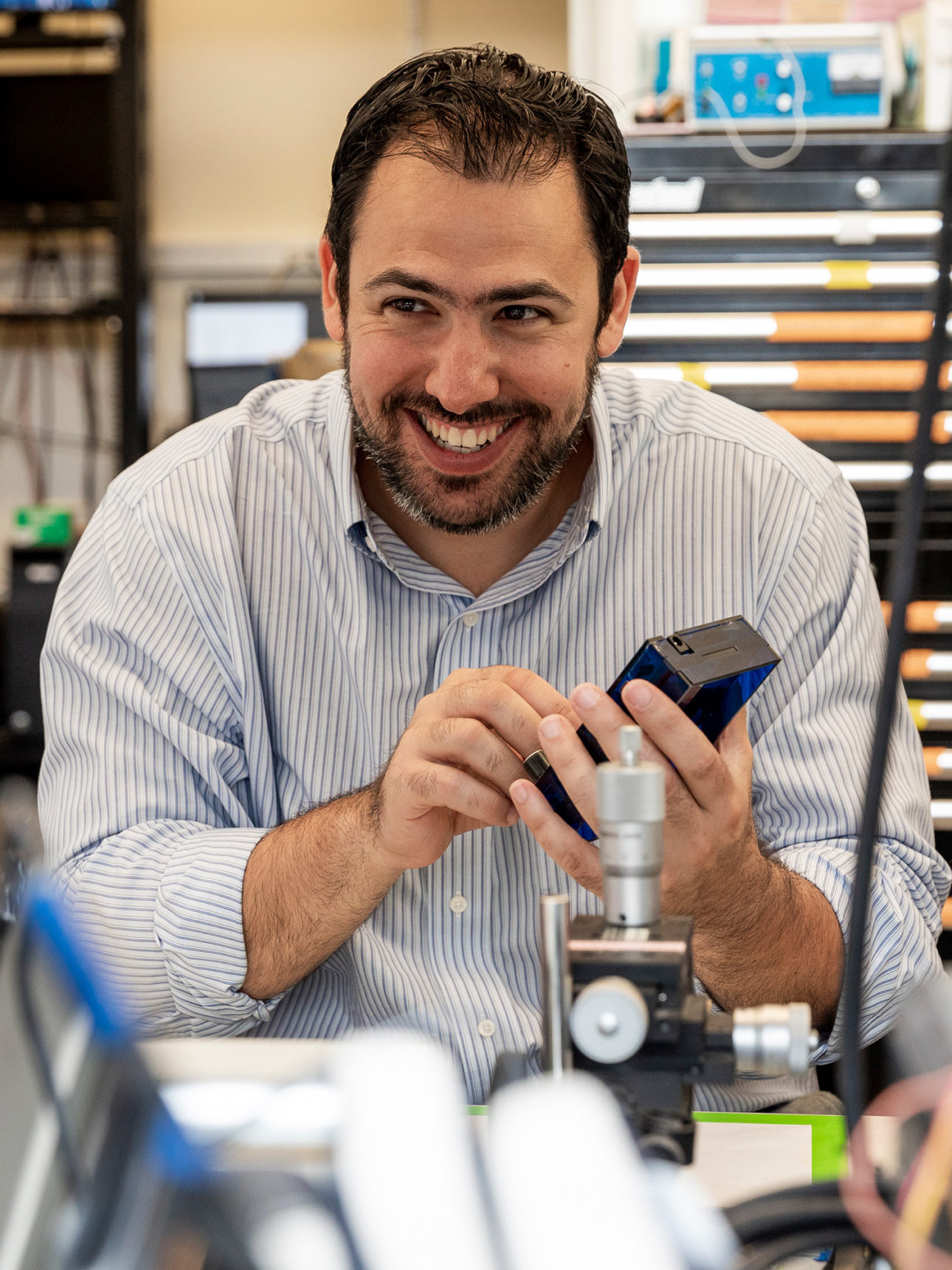 Portrait photograph of Michael Halassa in the lab.