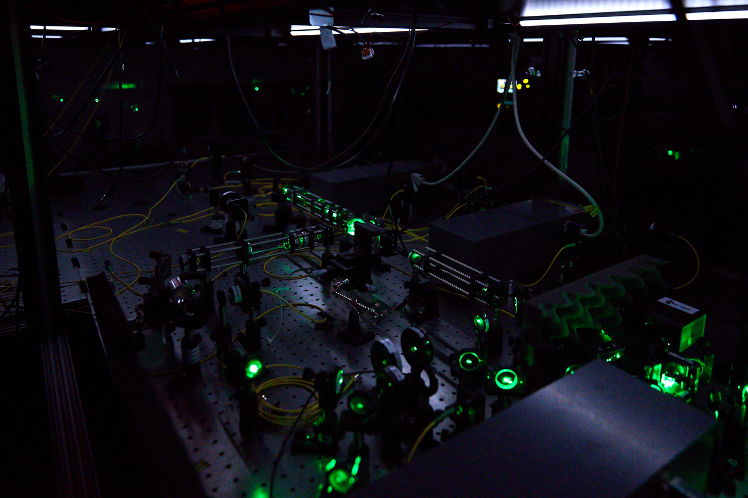 Equipment and optical tables in a laboratory at Delft University of Technology that houses a special crystal capable of storing quantum memory and serving as a network node for long-distance quantum communication.