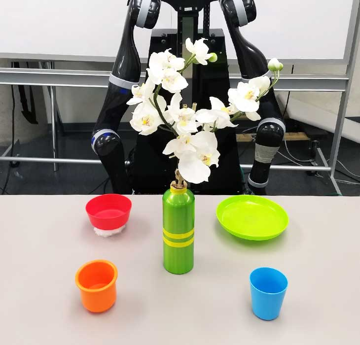 A robot arranging things on a table.
