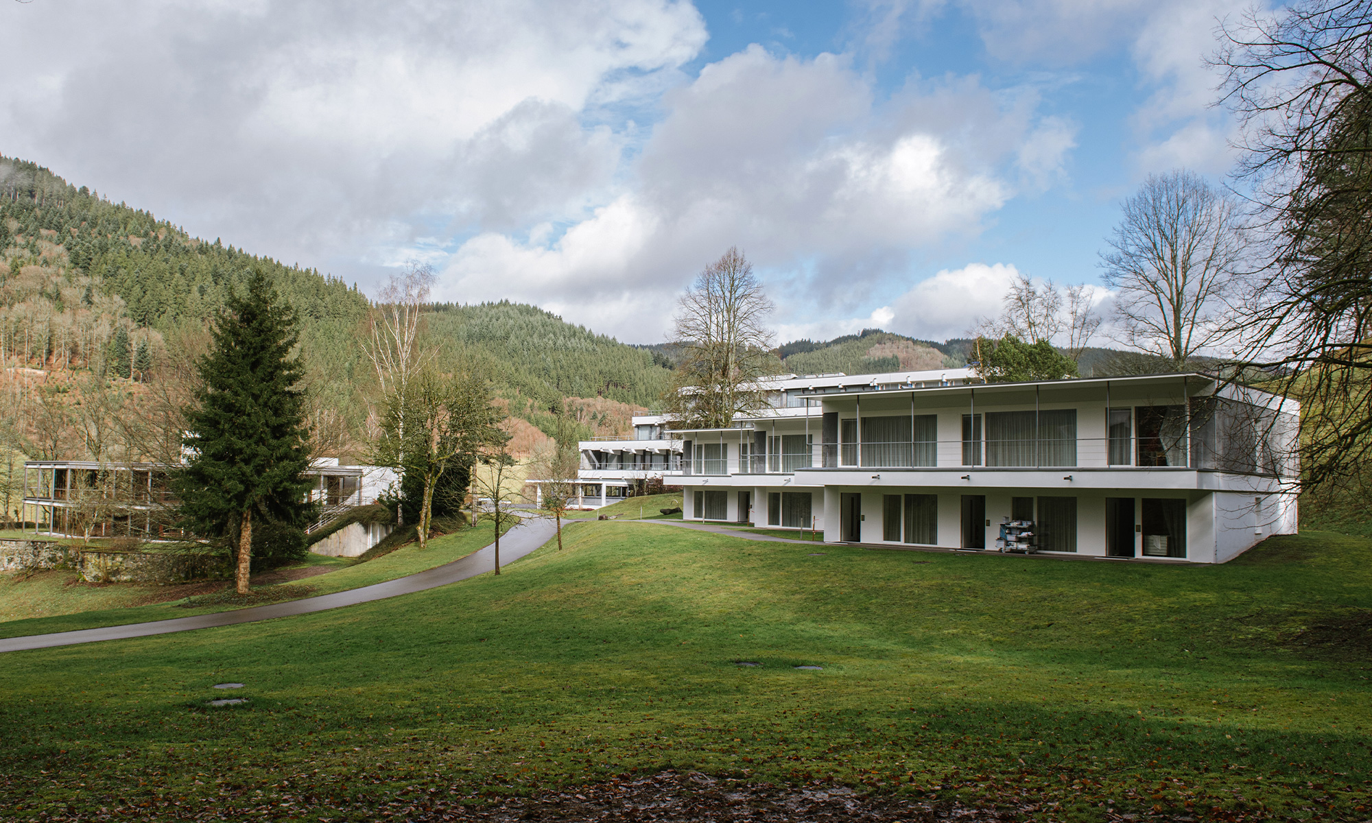 Photo of Oberwolfach buildings set against green hills and trees
