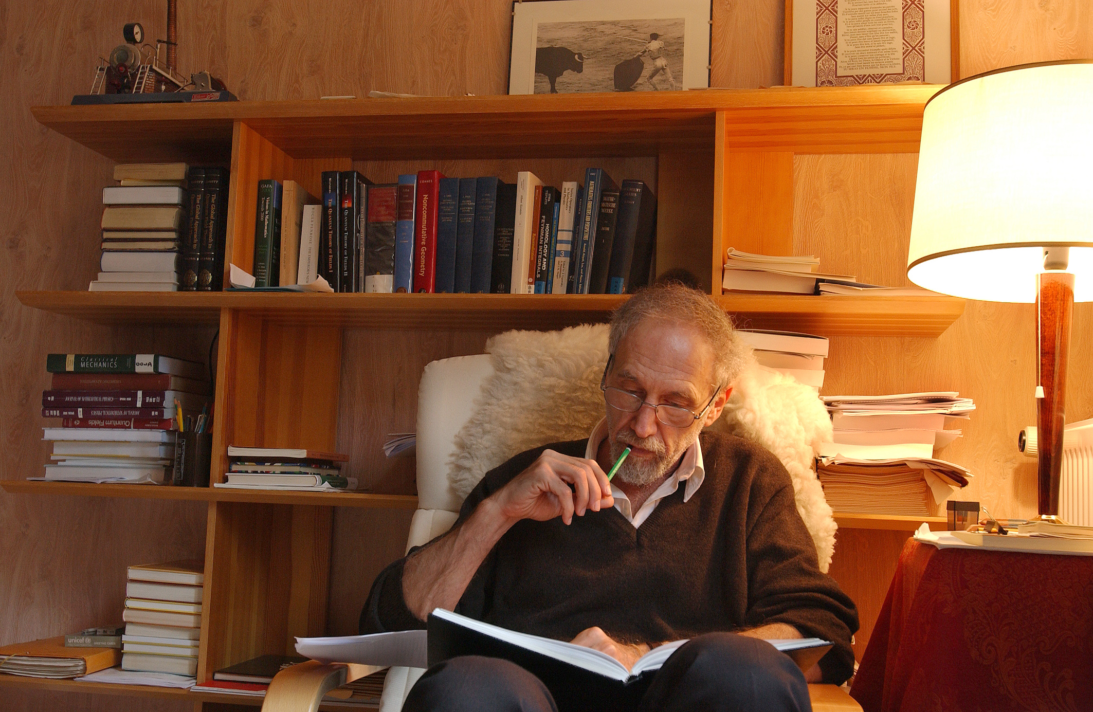 Photo showing Alain Connes working in an office