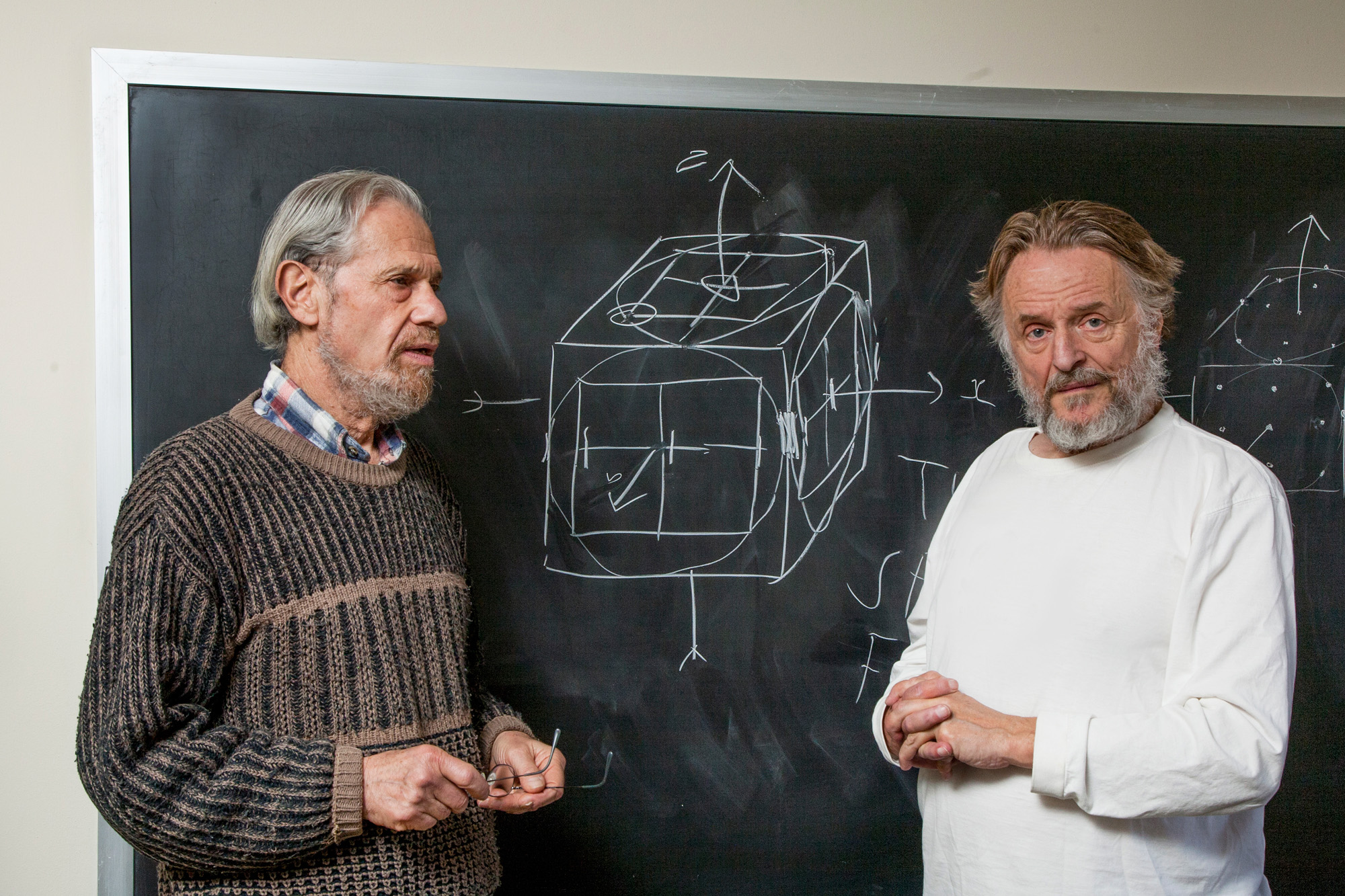 Photo of John Conway and Simon Kochen in front of a chalkboard