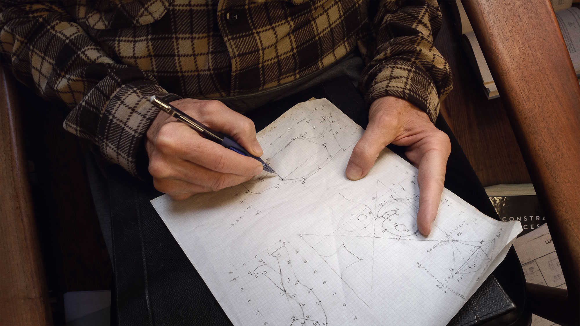 Photo of Donald Knuth drawing diagrams by hand, working on The Art of Computer Programming