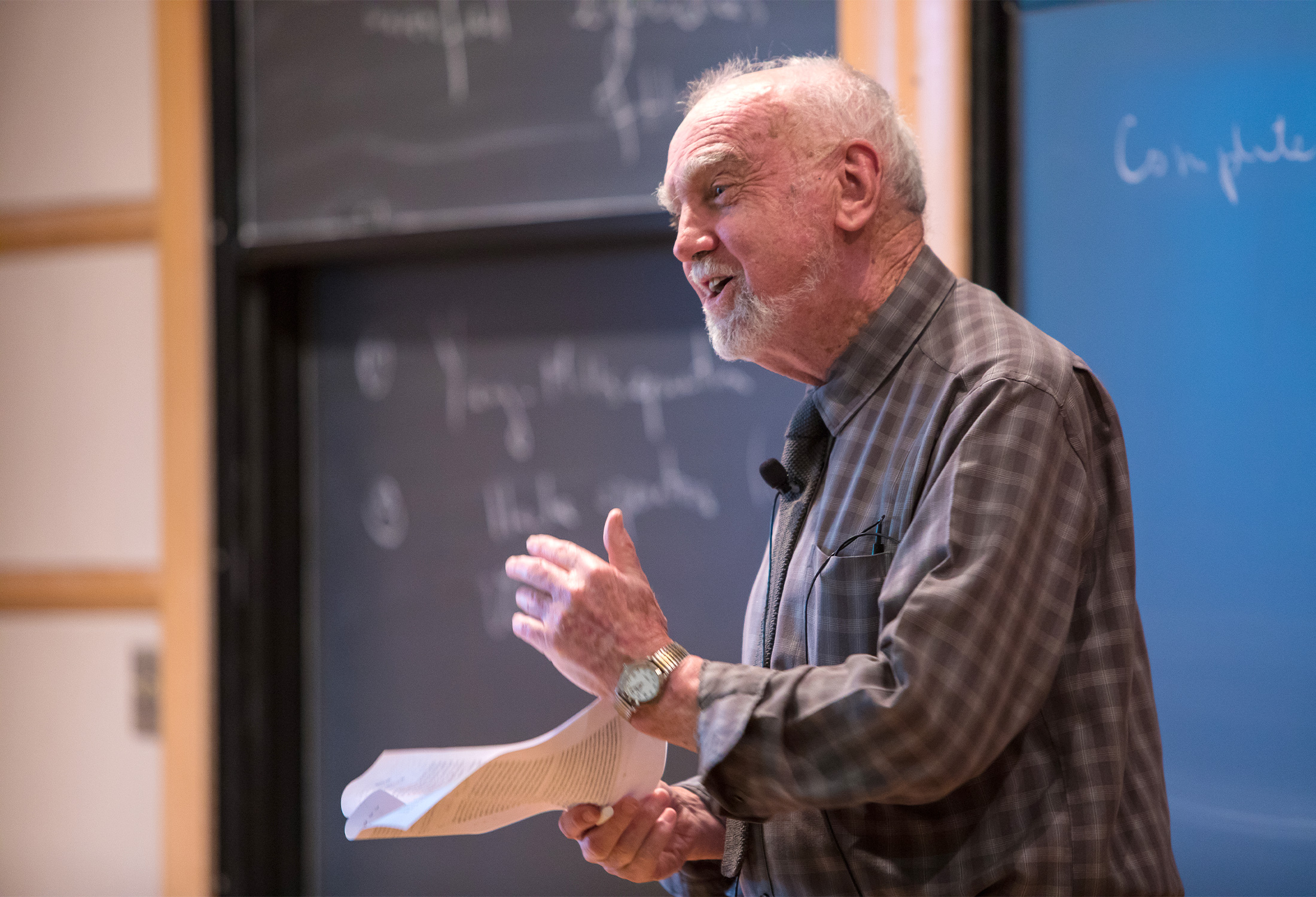 A photograph of the mathematician Robert Langlands giving a talk at the Institue for Advanced Study in 2016.