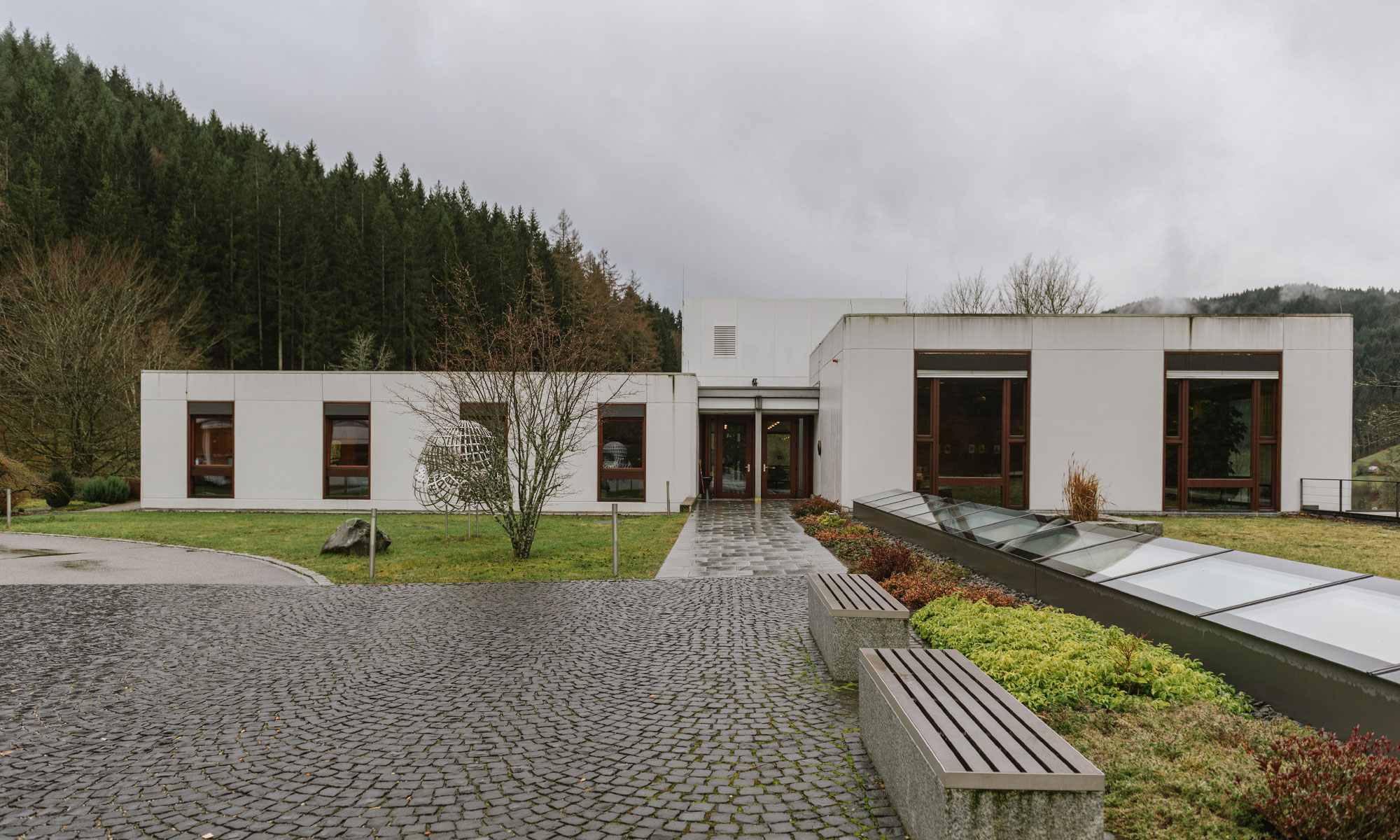 Exterior photo of the main building of the Oberwolfach Research Institute for Mathematics on a cloudy day