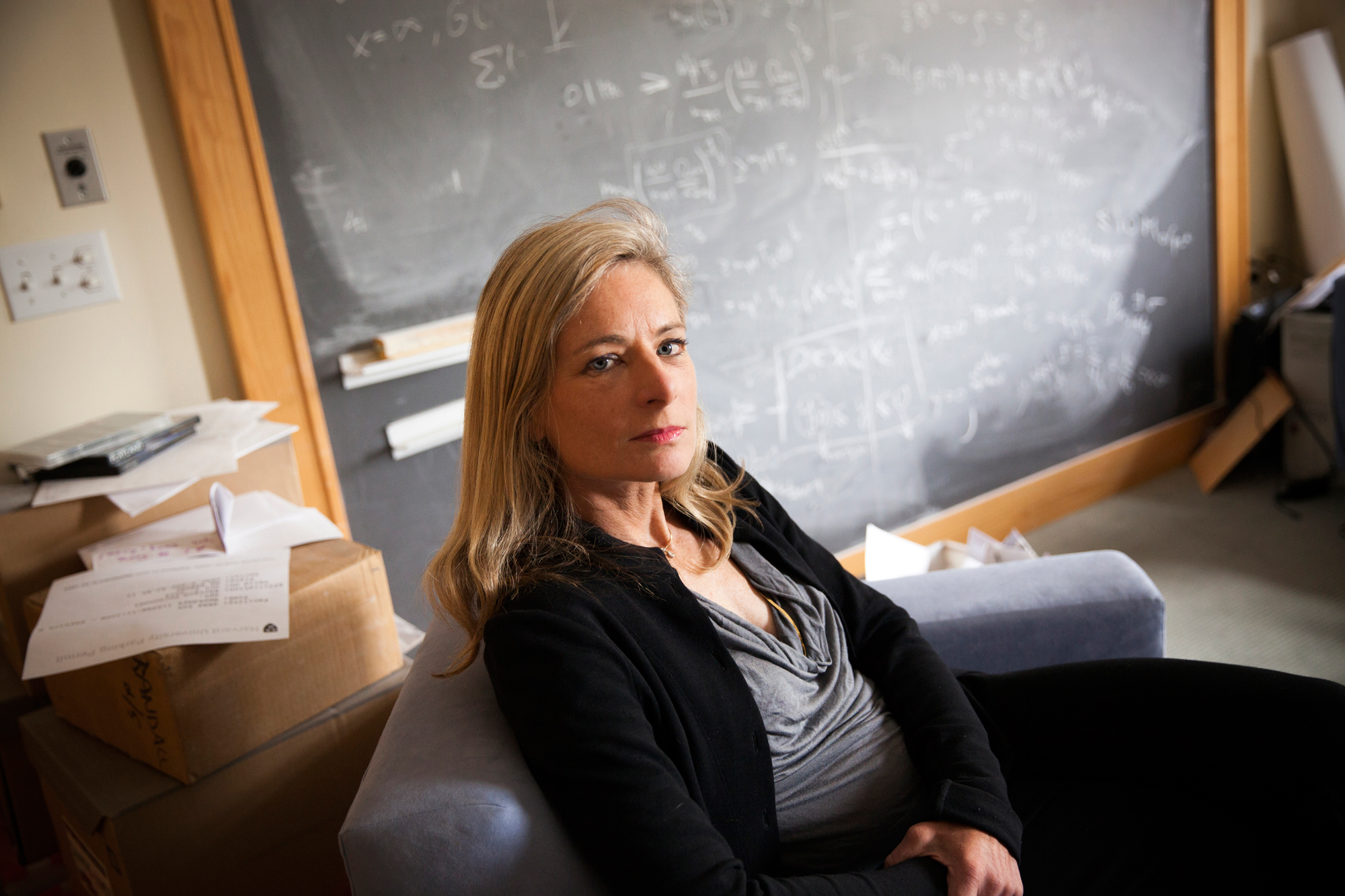 Lisa Randall framed by a blackboard in her office.