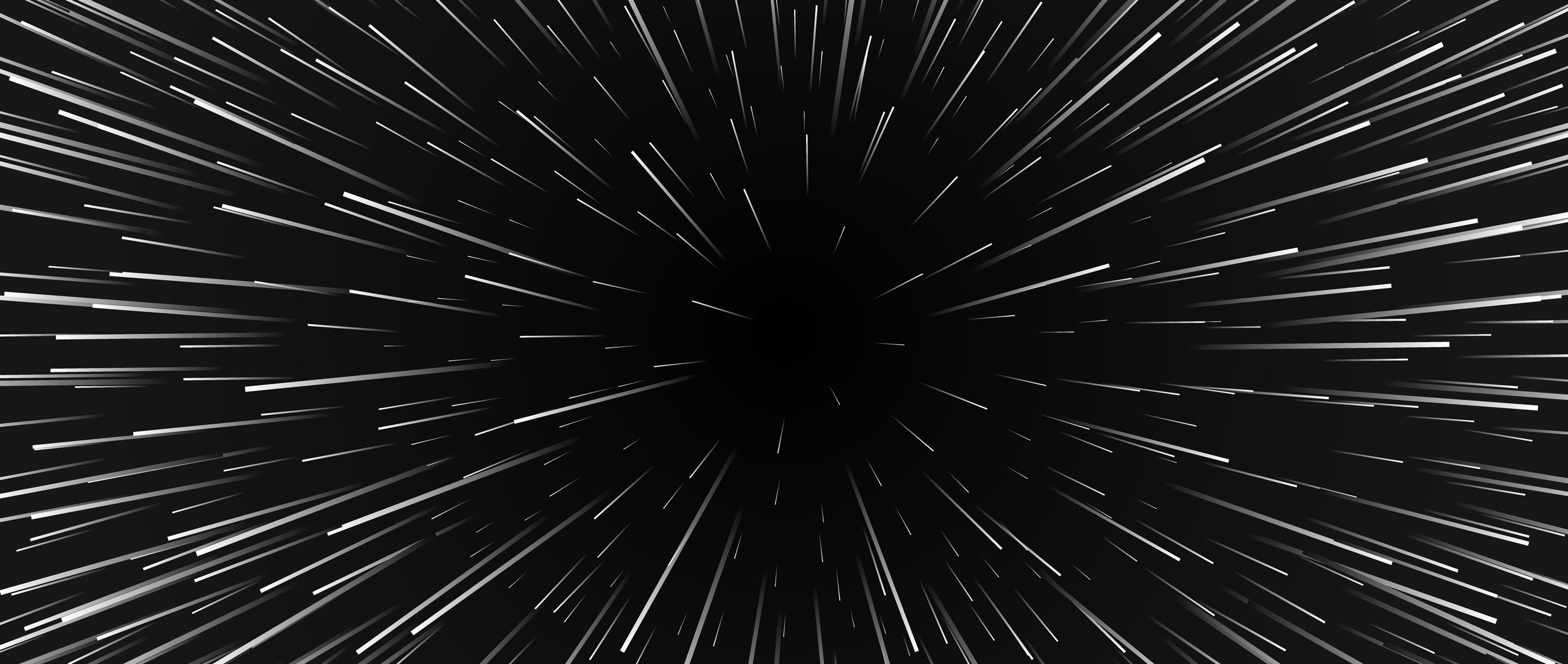An image of space with lines emanating from a central point, as if the viewer is traveling at warp speed.