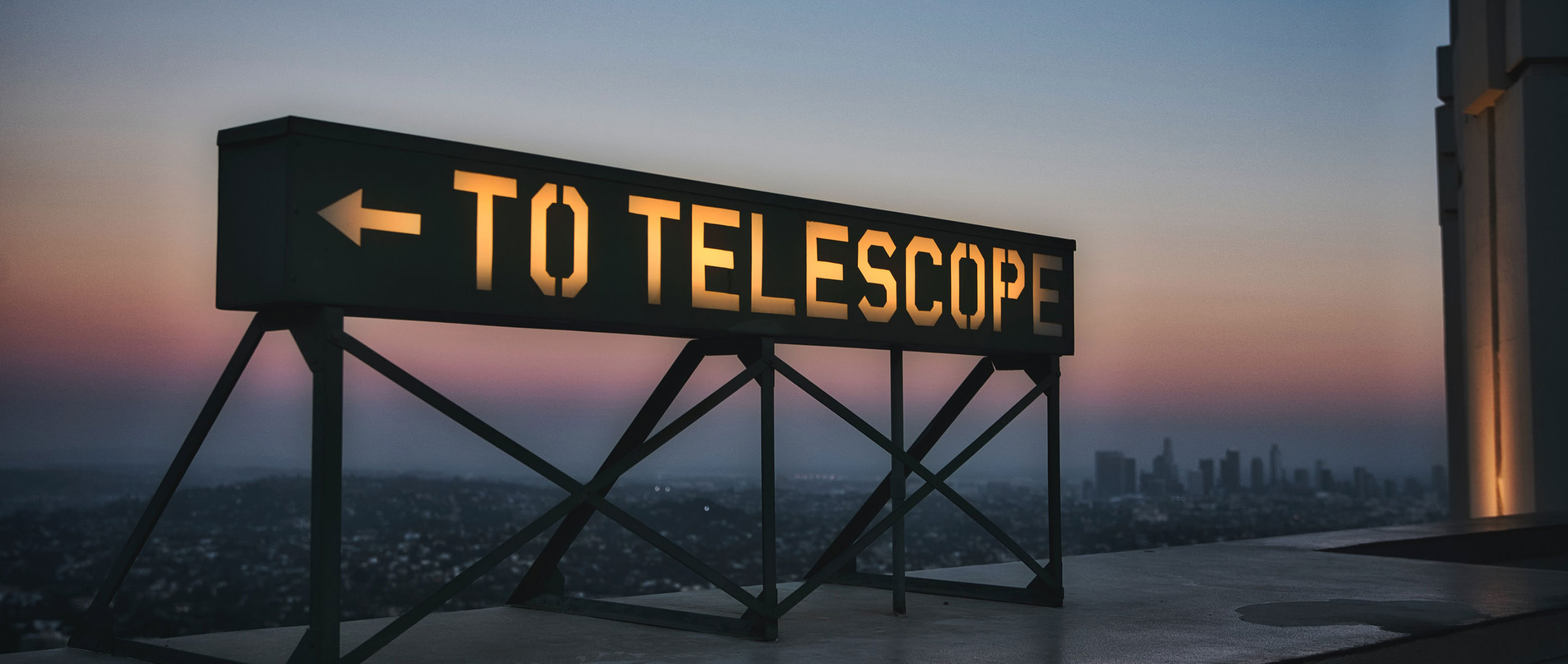 "Photo of a sign reading ""To Telescope"" near Griffith Observatory in Los Angeles."