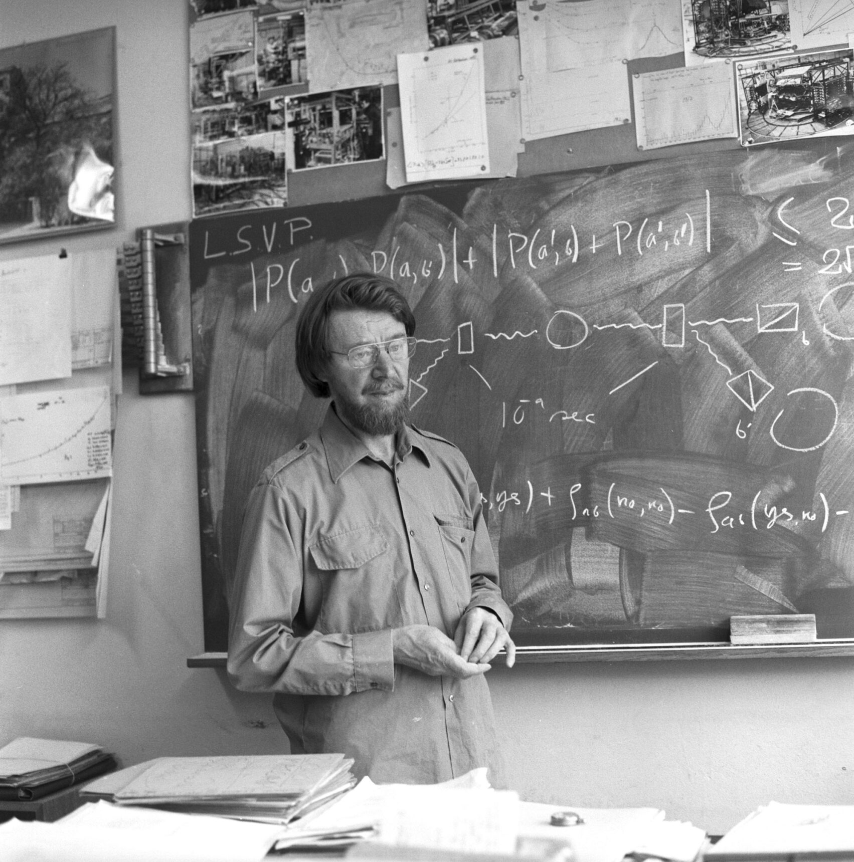 John Stewart Bell standing at a blackboard.