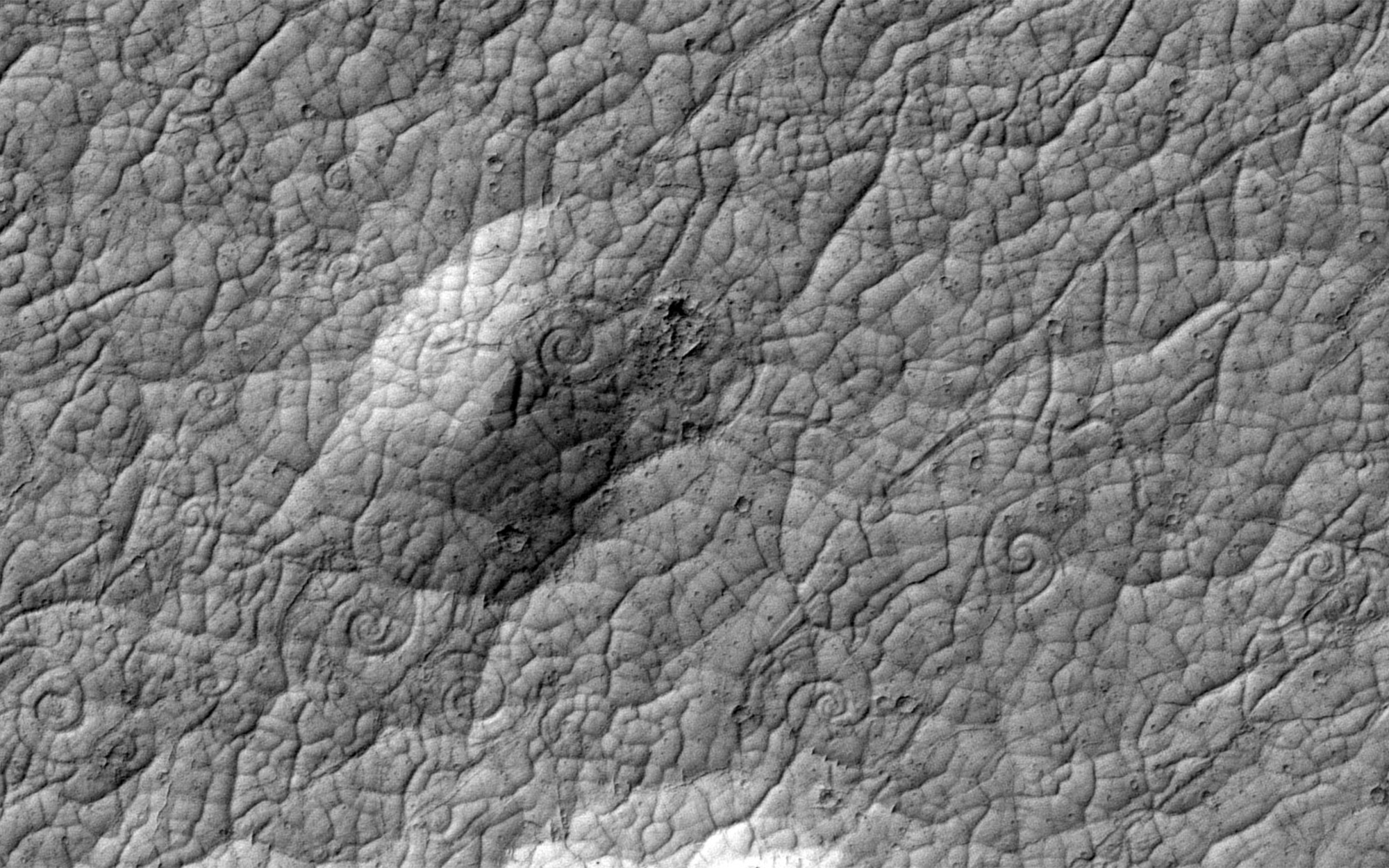 Grey images of Mars' surface showing lava flows.