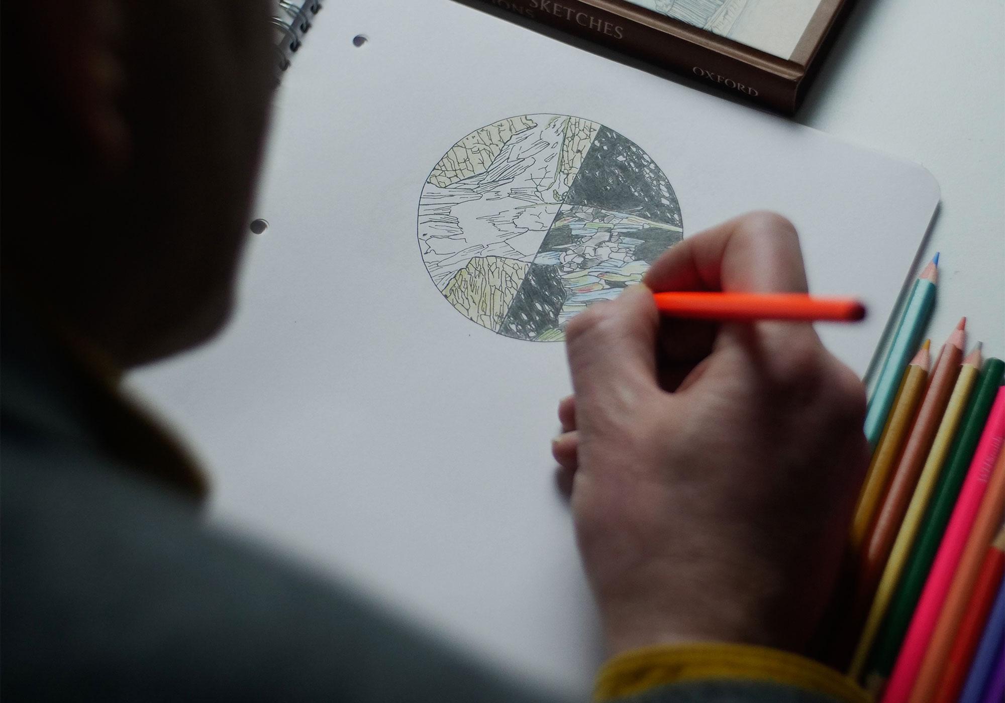 Matt Genge draws a circular slice of rock.