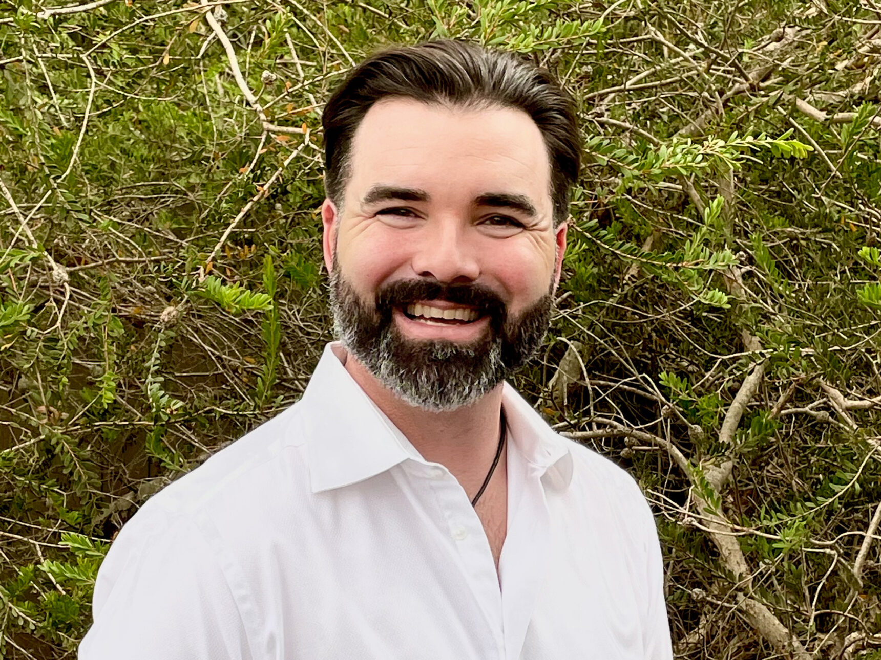 Photo of Bradley Voytek, an associate professor of cognitive science and data science at the University of California, San Diego.