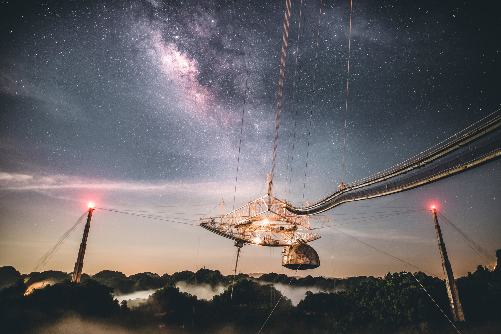 Photo of the Arecibo Observatory in Puerto Rico, with a starry night sky as background