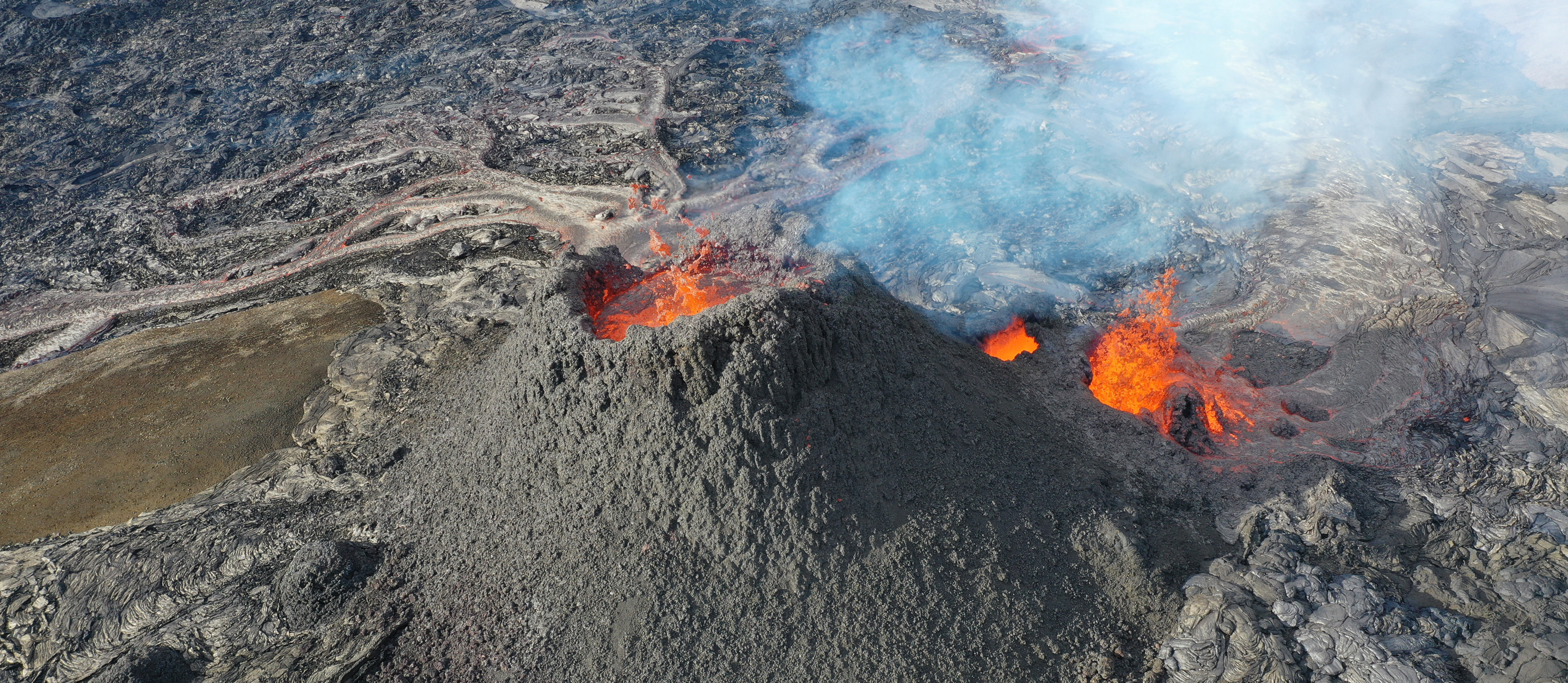 An aerial view of a volcanic cone.