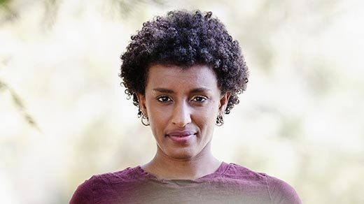 A close-up, head-on portrait of computer scientist Rediet Abebe.