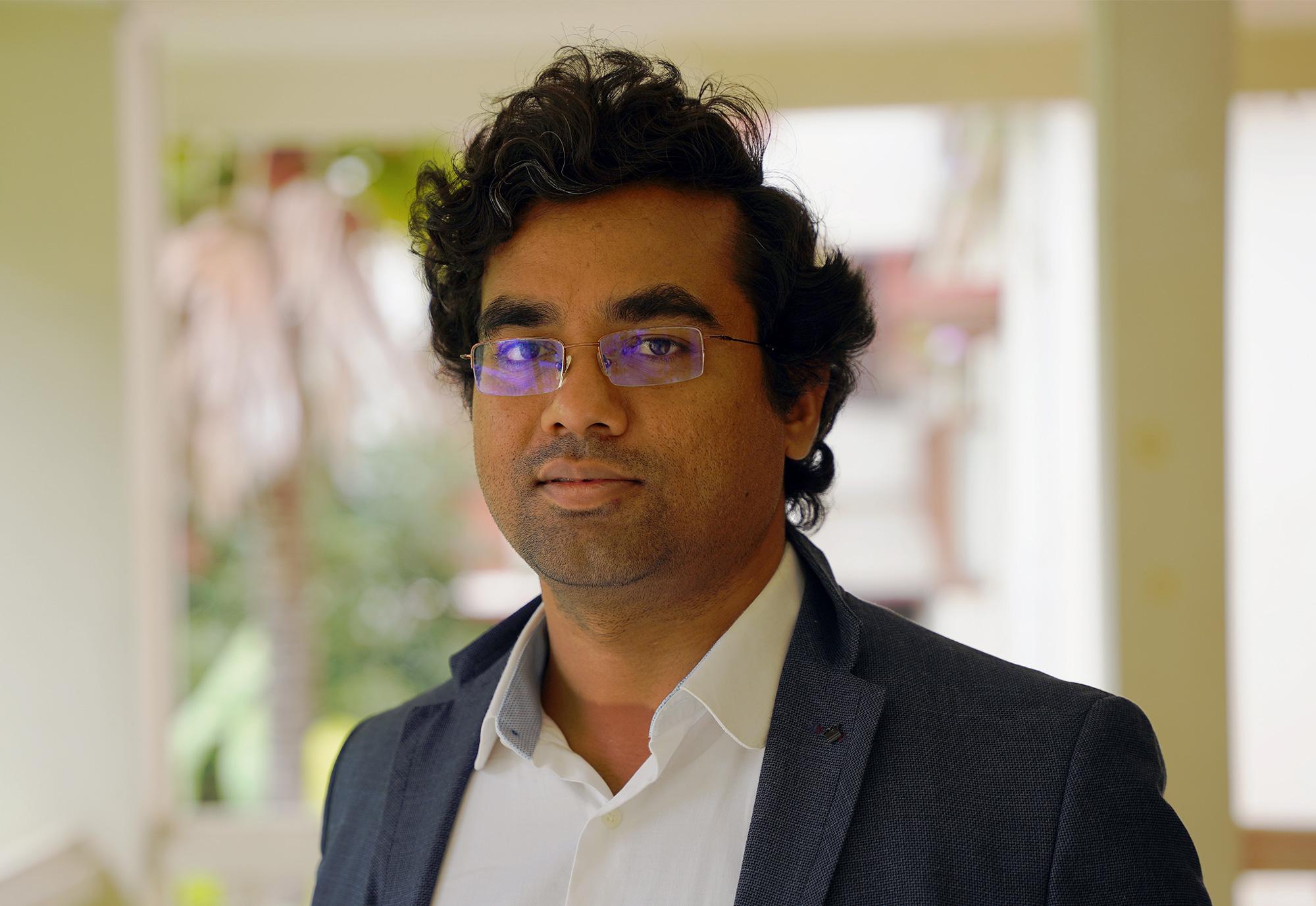 Photo of Mahesh Kakde in a suit jacket indoors