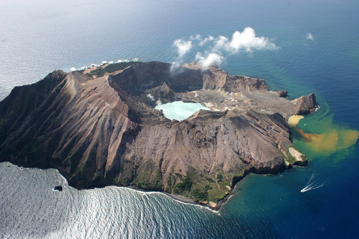A small mountainous volcanic island poking out of the sea.